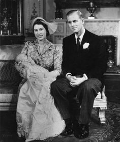21st October 1950:  Princess Elizabeth (later Queen Elizabeth II) holding her daughter Princess Anne at her christening in Buckingham Palace, with the Duke of Edinburgh at her side.  (Photo by Topical Press Agency/Getty Images) via @AOL_Lifestyle Read more: http://www.aol.com/article/news/2017/01/01/queen-90-misses-new-year-church-service-due-to-heavy-cold/21645308/?a_dgi=aolshare_pinterest#fullscreen