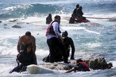 April 20, 2015: Migrants are rescued by members of the Greek Coast guard and locals after a wooden sailboat carrying dozens of immigrants ran aground off the coast of the island of Rhodes(Argiris Mantikos/Eurokinissi/Reuters)