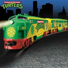 Illuminated electric train collection features Teenage Mutant Ninja Turtles art, removable sculpture. FREE track set, power pack, more - a $100 value!