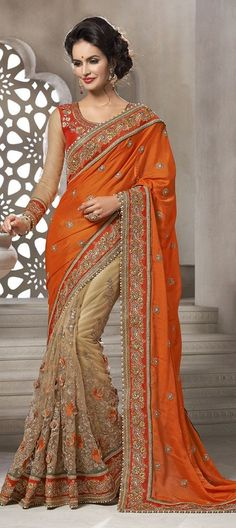 Bring a classy change to your feminine look this season by adorning this orange and beige color embroidered viscose net half n half sari. This enticing attire is showing some brilliant embroidery done with bead, lace, stones and resham work. Fancy Sarees, Party Wear Sarees, Indian Bridal Lehenga, Indian Sarees, Indian Dresses, Indian Outfits, Orange Saree, Stylish Sarees, Latest Designer Sarees
