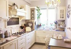Country style kitchen. Small kitchen idea. White kitchen cabinets.