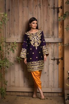 Royal purple raw silk kurta with gotapatti embroidery on gala daman and sleeves. Paired with orange color silk tulip pants. Asian Wedding Dress Pakistani, Pakistani Formal Dresses, Pakistani Fashion Casual, Pakistani Dress Design, Pakistani Outfits, Lehenga Wedding, Indian Dresses, Simple Kurta Designs, Fancy Dress Design