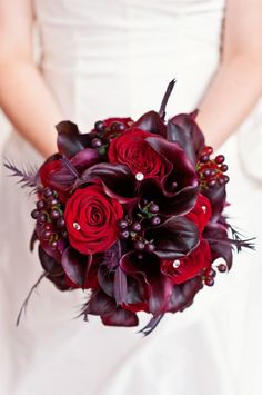 Gorgeous deep red and purple bridal bouquet. Wedding planning by Simply Wed. www.simplywed.com