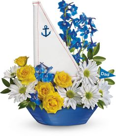 http://www.pinterest.com/arcadiafloral/floral-arrangements/  New baby boy arrangement in boat