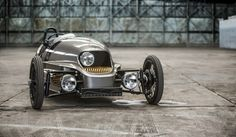 Vintage car manufacturer Morgan has released an electric version of their three-wheeled car, the The car weighs about and goes from zero to in nine seconds. Dan Neil walks us through the car at the Geneva Motor Show. Morgan Motors, Morgan Cars, Moto Cafe, Reverse Trike, Auto Motor Sport, Third Wheel, Geneva Motor Show, Retro Futuristic, Electric Cars