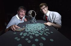 Metal detectorist David Blakey (left) with York Museums Trust's curator of numismatics Dr Andrew Woods (right) and the Wold Newton Hoard (image © Anthony Chappel-Ross)