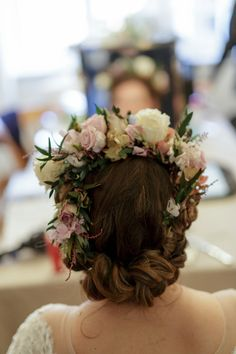 Bride wears a silk rose flower crown. Images by Charlie Davies Wedding Photography