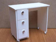 1/12th scale., For your miniature Beauty Salon, a Manicure Table.,Finished in white, with elegant silver knobs.,The drawers don't open.,
