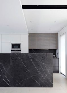 black marble + white + textured grey + minimal kitchen
