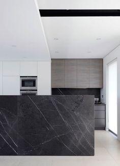 black marble + white + textured grey + minimal kitchen