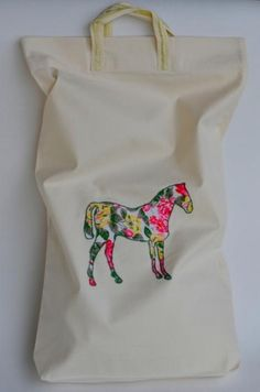 Although we love linen, we sometimes use other textiles too. Everything to make you happy!  Sprightly, natural, cotton bag with embroidered, flannel, colorful, joyful horse. Ideal for shopping, travels or just for everyday clobber. Designed and (hand)made with love by JakSen.  Cotton is very resilient, smooth and soft. Easy to use. Really hypoallergenic just like LINEN – fibre we use mostly and with all the passion we have.  Size: 50/35 cm and about 20/14 inches  We can make untypical size…