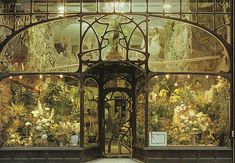 postcard showing the flower shop which now occupies what was originally the Chemiserie Niguet in Brussels. The shop is in the Rue Royale, and the Art Nouveau storefront was installed in 1896 from a design by Belgian architect Paul Hankar (1859–1901).