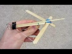How to make a Mini Crossbow  This is an easy way to make a mini crossbow with several commonly found household items. I noticed that many of the simple crossbows use rubber bands for the string as the power, so I changed up the design. The power still comes from the rubber bands but they are used in a scissor type of format. This should allow the rubber bands to last for a long time.  My son loves this toy. homemade diy  www.specificlove.com