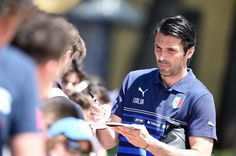 Gianluigi Buffon of Italy sign autographs for fan after a training session at Coverciano on June 2, 2014 in Florence, Italy.