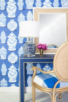 Chinoiserie blue & white parsons table, wallpaper, ginger jar lamp, rattan