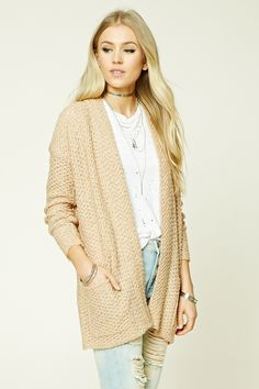 A midweight loop knit cardigan featuring an open-front, two front patch pockets, and long sleeves.