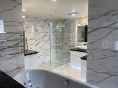 600x600 Rectified Gloss White Marble Look Glazed Porcelain Tile Installed by Dream Tiling Marble Look Tile, Black Marble, Tile Installation, Tiling, Travertine, Porcelain Tile, Bathtub, Standing Bath, Bathtubs