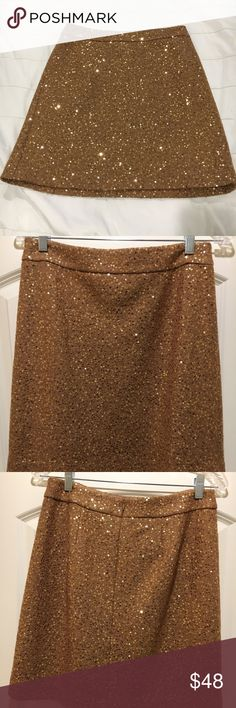 "Ann Taylor Loft Camel Skirt w/ Gold Sequins Size 4 Mini skirt—dry clean only. Measurements of skirt- waist to hem 18.5"" waist 15"" shell of shirt is 63% Rayon 37% Wool. Lining of skirt is 100% Polyester.   In very good condition. Worn only a few times! No holes, snags, or damage. Ann Taylor Loft Skirts Mini"