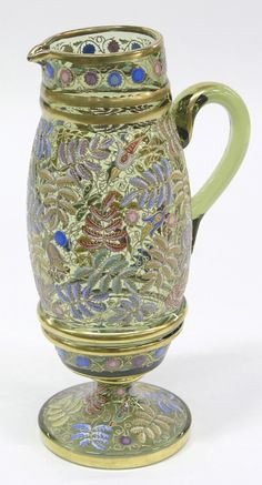Moser pale green glass pedestal foot pitcher having overall enamel and gilt floral decoration, circa 1880, 1025h