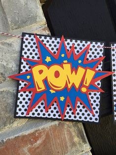 Defeat any party villian with this super hero, comic inspired banner! This comic inspired banner is a decoration you simply cant do without. Ideal for hanging above doorways, attaching to a party table or stringing across any wall, banister or mantel. It will be sure to catch everyones eye upon entering your celebration! Coordinate this banner with other party decorations listed in my shop to complete the look. Custom orders are always welcome and no extra design fees. BANNER DETAILS: •…
