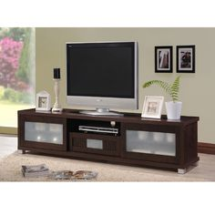 The generous top surface will accommodate a large television up to 85 inches flat screen TVs , while open compartments below are ideal for electronics components.