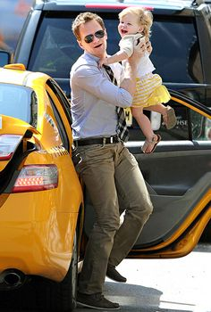 Neil Patrick Harris and a laughing Harper catch a taxi ride while running errands in New York City.