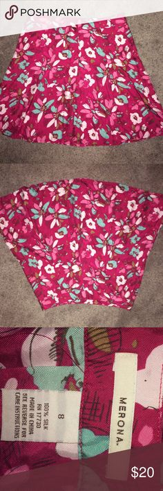 A-line floral skirt Beautiful fuschia colored a-line skirt with turquoise, pink and white flowers approximately 20 inches long.  It is 100% silk. I can't wear it anymore because my liver is too large and this skirt sits on the waist. Please make an offer. Merona Skirts A-Line or Full
