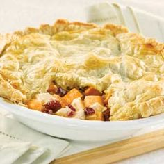 Here's a scrumptious use for leftover turkey. Warm from the oven, this home-style pot pie features turkey, sweet potatoes, dried cranberries and gravy topped with a tender, flaky puff-pastry crust. Puff Pastry Recipes, Pie Recipes, Puff Pastries, Recipies, Chicken Recipes, Turkey Recipes, Brunch Recipes, Yummy Recipes, Dinner Recipes