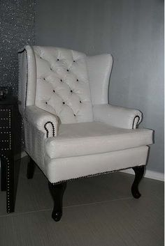 4007 BLACK AND WHITE CROC TUFTED ARMCHAIR   This handsome chair is upholstered in beautiful white croco and features high-gloss black legs. The two colors are brought together beautifully by a black nail head trim and black nail heads in the tufts. This is one elegant, sophisticated and utlra-glam chair.