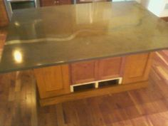 Custom made concrete counter top with metal river runnig through it. Top is 5' x7' long, River is in Ohio. Actual river from Google Images.