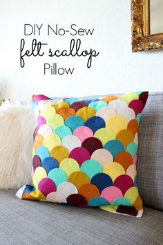 DIY Felt Scalloped Pillow - Love that this is a no-sew project. Click for tutorial - http://www.classyclutter.net