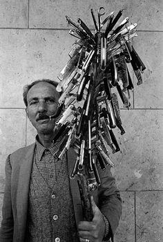 Ferdinando Scianna ITALY, Sicily, Bagheria: Seller of knives.