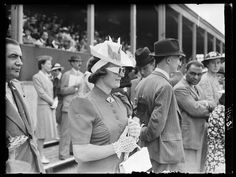 photograph of a woman watching the Royal Richmond Horse Show, taken in June 1939 by Edward G Malindine