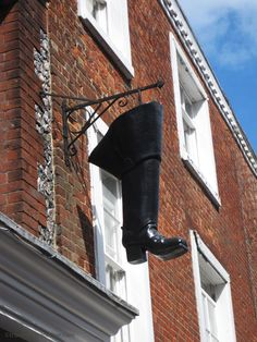 Shoe shop sign in Winchester, Hampshire England