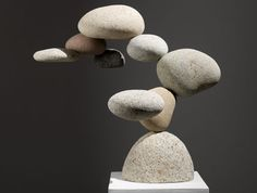 """These stones, gathered from the Pacific Ocean in Mexico, seem completely oblivious to any rules of weight and mass. California artist Woods Davy's new sculpture series, """"Cantamar,"""" features a variety of rocks in gravity-defying formations."""