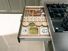 Under Stove top drawer for cooking utensils & spices!