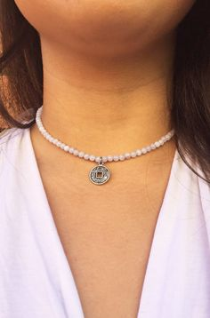 This sweet little choker is an everyday settle piece that can make a bold statement. It has periwinkle agate beads that are fun and vibrant and can lighten up any outfit. The silver medallion adds an