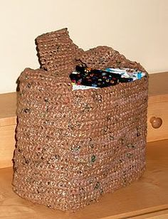 its a crocheted bag... made of grocery bags! ITS SOOO COOL