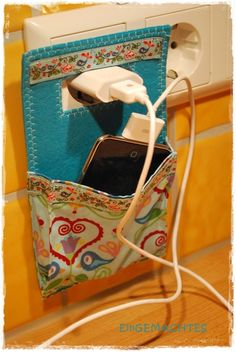 Charging Pocket- how cute is this?! What a great idea to keep electronics off the floor!