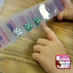 Using dice in pill containers for place value