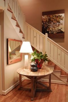 Simple wood slats in a frame make for an easy-to-build and economical railing. The small cutouts provide that little touch of detail that makes the railing special.