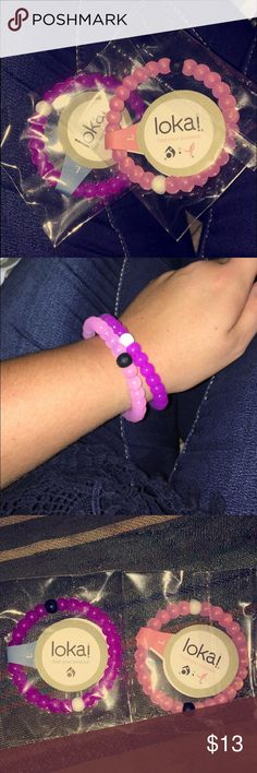 2 large Lokai bracelets purple and pink Two size large Lokai bracelets. New in package, only worn to take pictures for listing. Brand new. One pink, and one purple.  The pink is a limited edition in honor of breast cancer. If you're looking for anything in particular, let me know. I have several that I purchased from a boutique that was going out of business. Lokai Jewelry Bracelets