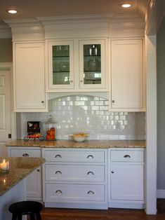 Crown molding takes these cabinets to the ceiling