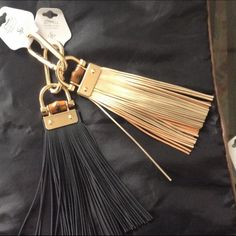 Black leather tassel bag charm/keychain NWT. Gold finish hardware on faux leather tassel. Stylish accessory. Brand new. High quality. Celebrity & designer inspired . Wow factor to any plain bag. Accessories Key & Card Holders