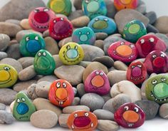 cute colorful handpainted stones - maybe for the garden?