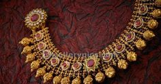 Nakshi beads antique jewellery set Apranjee jewellers. this has patch of gold mesh chain allover with rubies