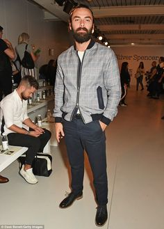 Spot the difference? Aidan Turner looked world's away from his hunky on-screen alias as he stepped out to enjoy the Oliver Spencer fashion show in London on Friday