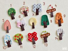 Little tree brooches made from fabric, felt and leather. They can be pined on many things you want! shirt, hat, bag, jacket, etc. Try it and see how it make your stuff look better! They are my original design. Cut and sew with love. They are different sizes, not larger than 4.3 cm