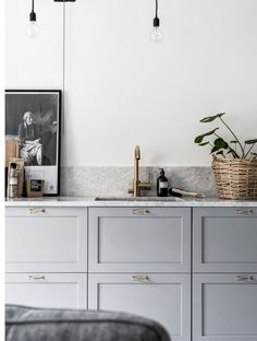 gray cabinets with brass and marble