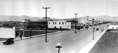 """Early development along Van Nuys Boulevard, 1913. All of these buildings have been torn down and replaced, except 6211 Van Nuys Boulevard, now known as the Van Nuys Hotel, visible here with the """"Hotel"""" sign on it. Los Angeles Valley College Historical Museum. San Fernando Valley History Digital Library."""